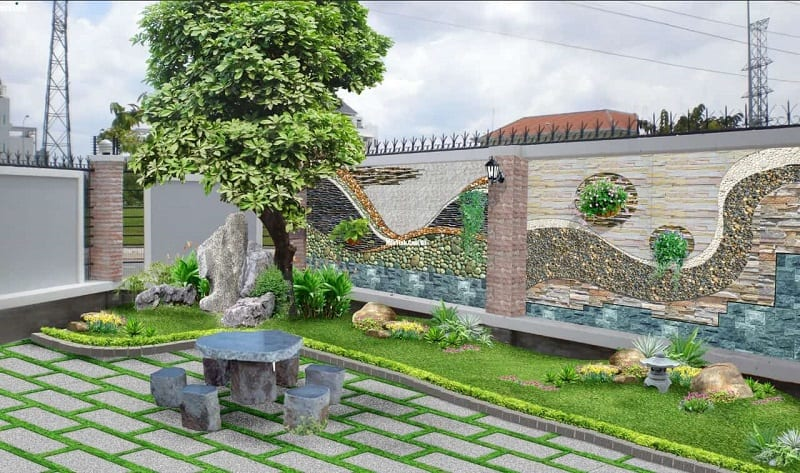 Tiểu cảnh trước sân nhà rộng rãi, có cây xanh lớn, cây canhe nhỏ và thảm cỏ, bộ bàn ghế đá