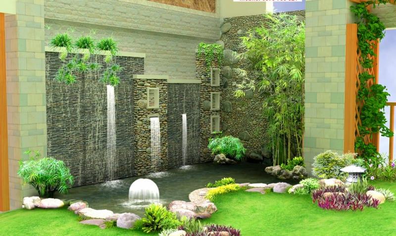 Tiểu cảnh sân vườn thác nước trên tường chảy xuống hồ nước nhân tạo, xung quanh là đá, thảm cỏ, cây xanh